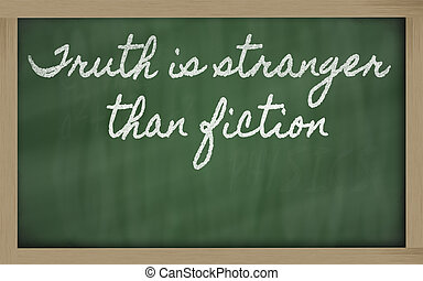 expression -  Truth is stranger than fiction - written on a scho