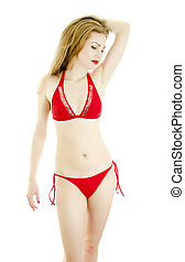 Pretty girl in red swimsuit posing. Isolated on white.