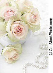 White roses in a vase on white background