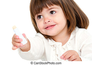 Portrait of little girl with lip balm. - Portrait of cute...