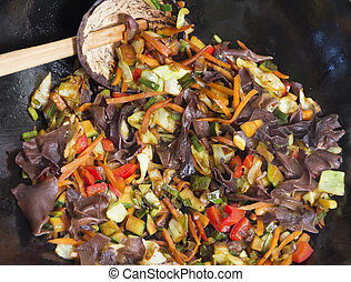 Mixing food in wok - Mixing chinese food, various vegetables...