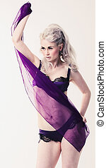 Young woman in purple lingerie