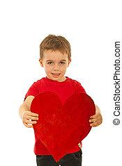 Boy offering heart shape