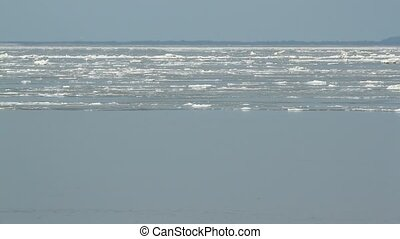 Floating ice is passing by