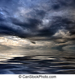 dark cloudy stormy sky with clouds and waves in the sea -...