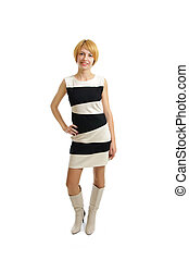 attractive young student woman in black and white dress with yellow hair and blue eyes standing isolated on white background
