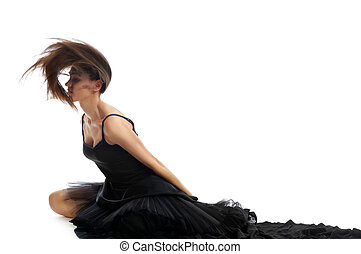 dynamic shot of a female ballet dancer shaking her hair and throwing it back isolated on white background