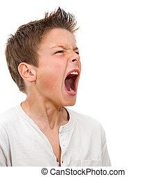 Close up portrait of boy shouting - Close up portrait of...