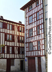 Typical Basque houses in the city of Bayonne with a blue sky