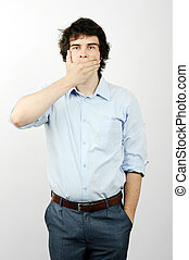 Secrecy - An image of a man with his hand on his mouth