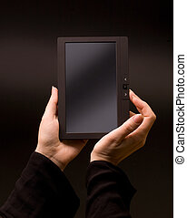 hands holding tablet pc - Woman hands holding electronic...