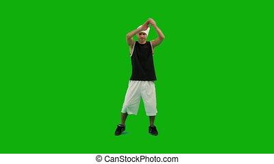 Guy Dancing Hip-Hop - A guy dancing hip-hop against green...