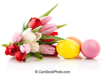 Easter eggs and tulips - Colored easter eggs with bouquet...