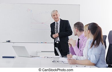 Senior business man giving a presentation - Senior male...