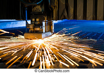 Laser cutting close up - Laser cutting with sparks close up