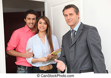 young couple and realtor
