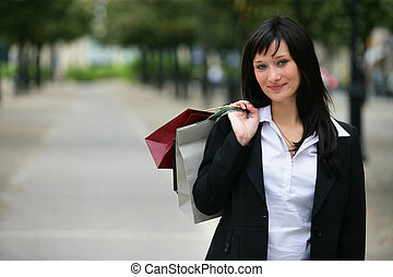 Woman in the city holding shopping bags