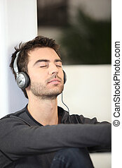 Man listening to music with eyes shut