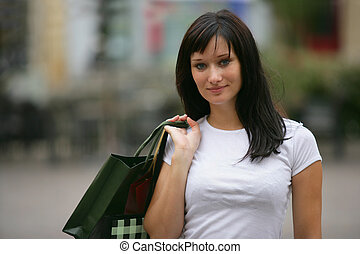 Woman on successful shopping trip