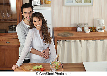 happy couple making a salad