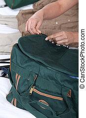 Woman packing bag