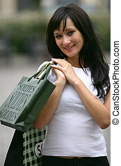 Woman in the street with shopping bags