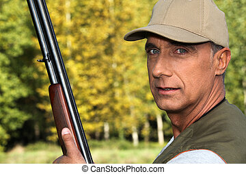 Hunter with a shotgun