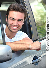 young man sitting in his car