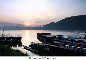 Sunset at river song landscape, Laos - Sunset at port near...