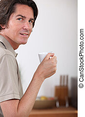 portrait of a man with coffee cup