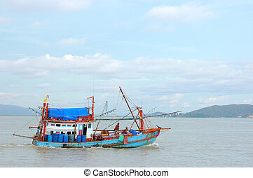 The fishing boats go to open sea on sunnyday at...
