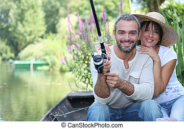 Romantic couple fishing on the river