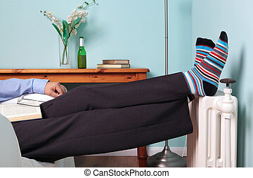Feet up relaxing - Photo of a man relaxing with his feet up...
