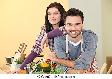 Couple preparing a meal together