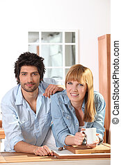 Couple having a coffee in a kitchen