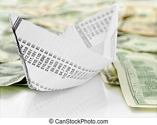 Paper Boat - Origami paper boat made from financial document...