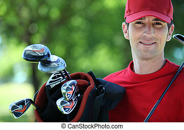 Golfer with club on his shoulder.