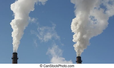 factory chimney with smoke under blue sky. HD H.264