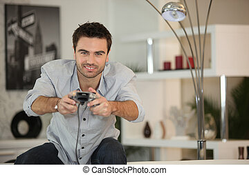 Competitive man playing video games