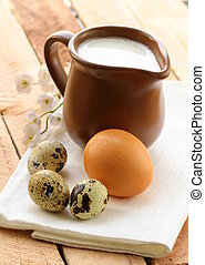 Ceramic jug with milk and eggs