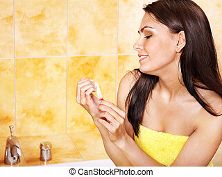 Woman polishing fingernails with nail file - Woman polishing...