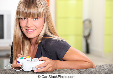 Blond teenager playing video games