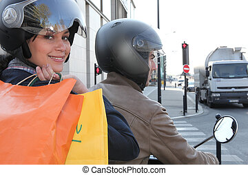 two people on a scooter