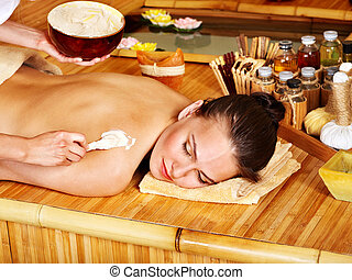 Salt massage - Young woman getting salt massage
