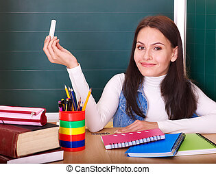 Teacher writing on blackboard. - Happy teacher writing on...