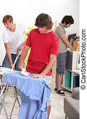 Young men doing their household chores