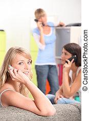 Young women making calls