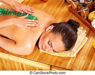 Salt massage. - Young woman getting salt massage.