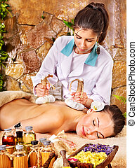 Woman getting massage in spa. - Young woman getting massage...