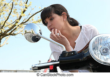 young woman on scooter